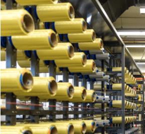 aramid yarn bobbins stored in a store room