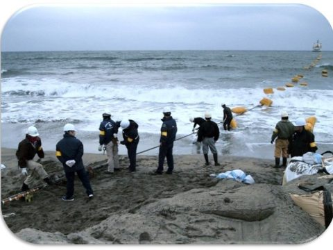installation crew pulls submarine fiber optic cable on a sea shore