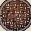 Sewer duct cover with word Sewer written on it