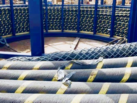 Submarine fiber optic cable coiled in big loop ready for deployment