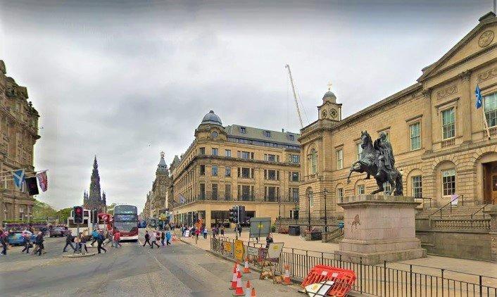 Edinburgh city with statue of Wellington and buildings